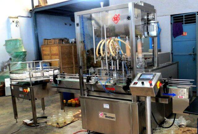 Four Head Ghee Filling Machine